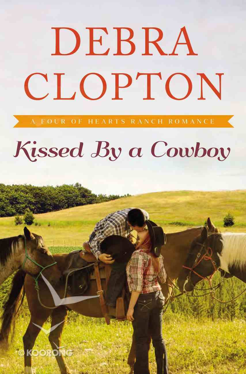 Kissed By a Cowboy (#03 in Four Of Hearts Ranch Romance Series) Paperback